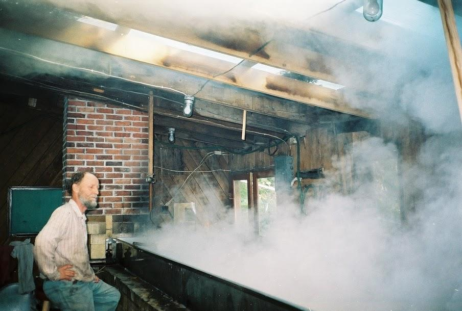 boiling down sorghum syrup at Sandhill Farm